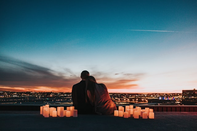 couple facing the city